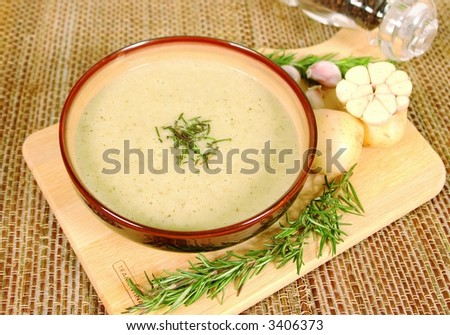 Home made potato and garlic cream soup - stock photo