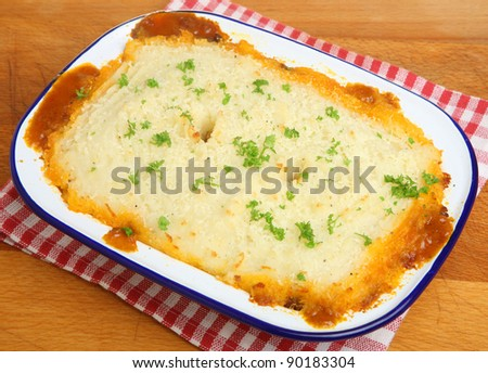 Home-made shepherds pie in traditional enamel dish. - stock photo