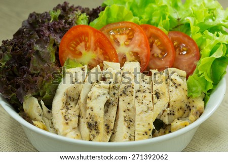 Home-made style pan-fried chicken breast with black pepper, serve with fresh salad and tomato slices - stock photo