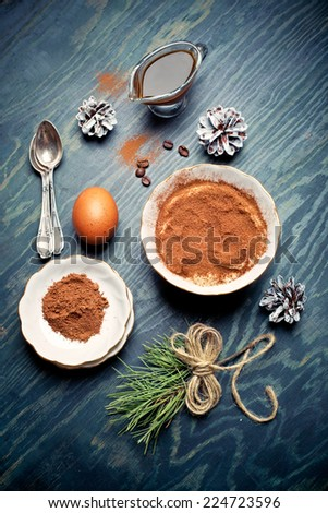 Home-made tiramisu and ingredients for it, with Christmas decorations - stock photo