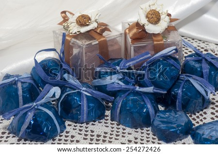 home made weddings favors on fabric background - stock photo