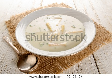 home made white asparagus soup with fresh parsley - stock photo