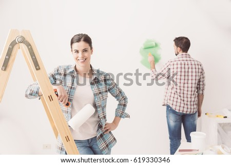 Home Makeover And Renovation Young Couple Redecorating Their New House And Painting Walls The