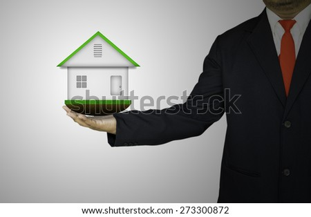 Home model in hand - stock photo