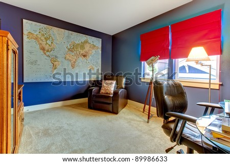 Home office interior in blue with red curtains.