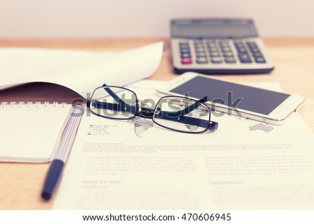 Home Office Papers And Glasses, Smart Phone, Pen On Wooden Table  Background.Vintage