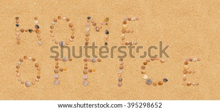 Home Office. Written in sand using single seashells at the beach. Holiday concept.