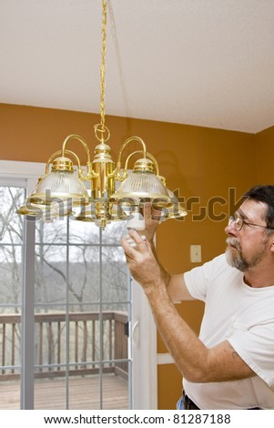 Home owner install energy saving light bulbs in dining room,bathrooms & kitchen to save energy & money