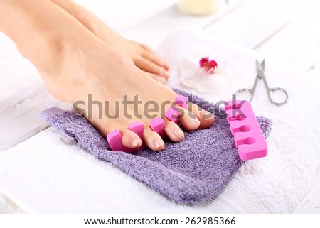 Home pedicure. Foot care treatment and nail, the woman at the beautician for pedicure. - stock photo