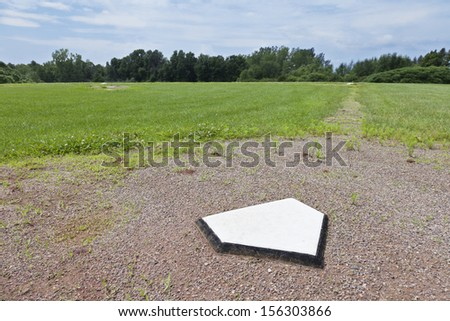 Home plate of a baseball diamond in a rural community. - stock photo
