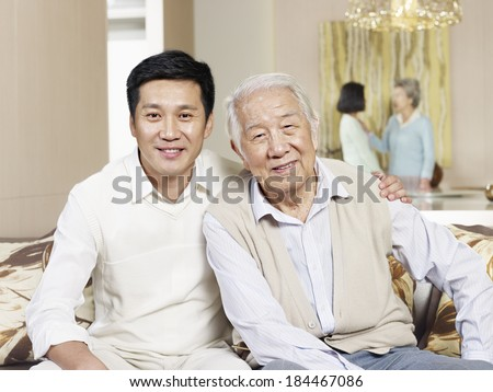 home portrait of asian father and son - stock photo