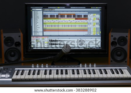 Home recording studio. Screen keyboard, speakers and microphone. - stock photo
