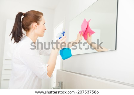 home related cleaning younger adult mother - stock photo
