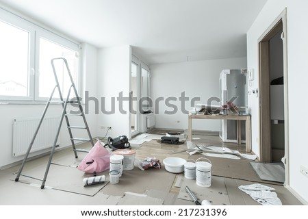 Home renovation in room full of painting tools - stock photo