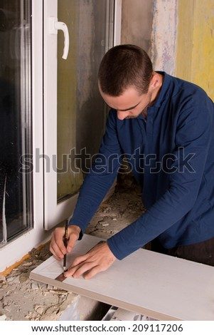 home repairs, replacement windows, measure and draw - stock photo