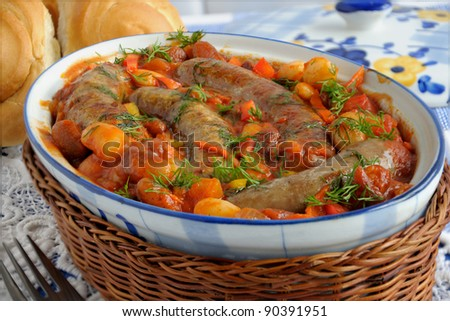 Home sausage with beans, onions and carrots in a tomato sauce