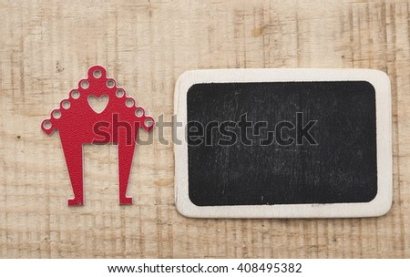 home shape and blank chalkboard on wooden table top - stock photo