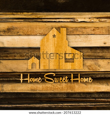 home silhouette sign on wooden planks - stock photo