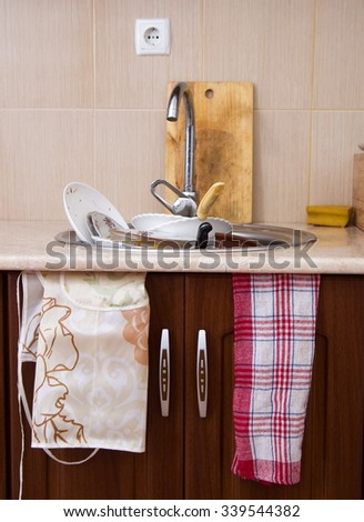 home sink full of dirty dishes - stock photo