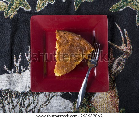 Home Style corn bread being served on a small plate with a fork. - stock photo