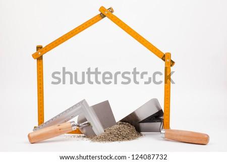 home symbol and mason tools - stock photo