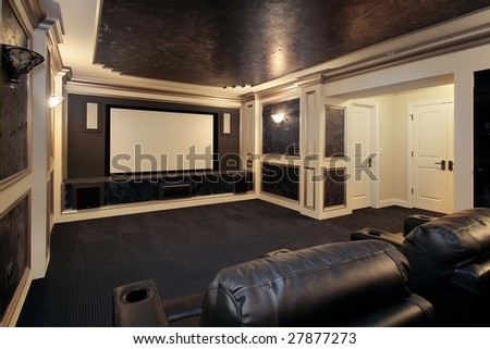 Home theater in luxury home - stock photo