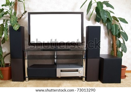 Home theater with empty white isolated screen - stock photo