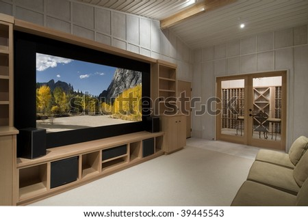 home theater with wine tasting room, big screen, wood cabinets,photo on screen is one of my shots from yosemite - stock photo