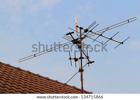 Home TV antennas mounted on a roof