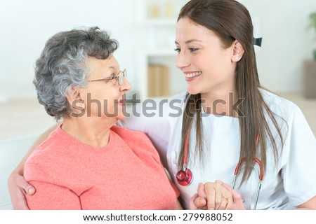 Home visiting an old patient - stock photo