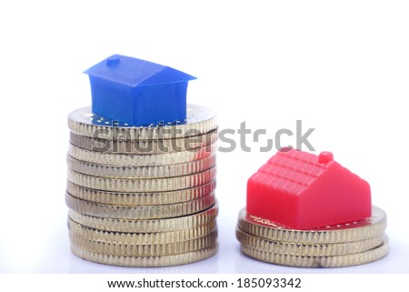 Home with coin isolated on white background - stock photo