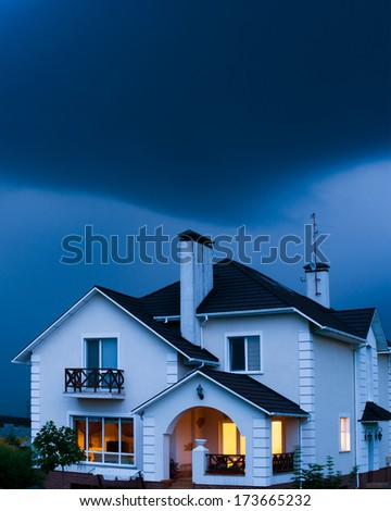 home with dramatic sky  - stock photo