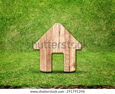 home wood icon in green grass room,Eco concept. - stock photo