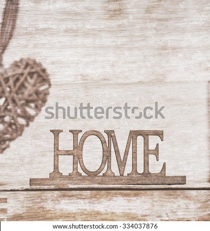 home, wooden text on vintage board background - stock photo