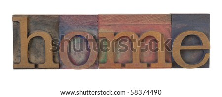 home - word in vintage letterpress printing blocks, stained by color inks, isolated on white - stock photo