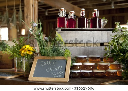 homegrown and homemade variety of herbs, honey, and vinegar - stock photo