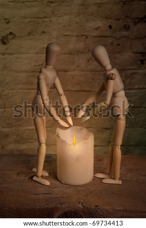 homeless dolls warming hand on fire with sick companion