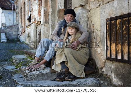Homeless family is begging on the street - stock photo