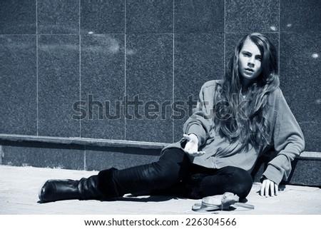 Homeless girl asks alms - stock photo