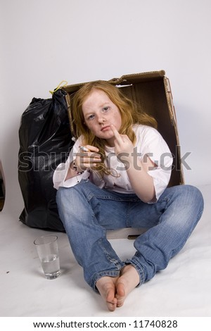 homeless girl showing the middle finger - stock photo