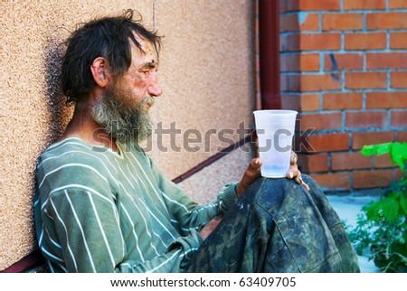 Homeless in depression. - stock photo
