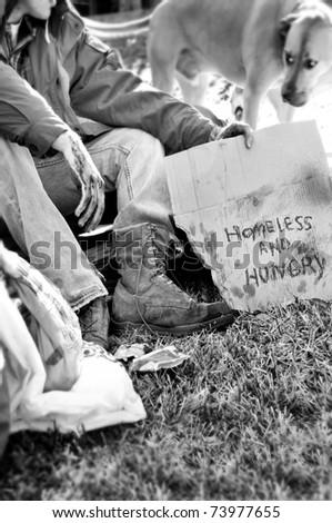 Homeless man and dog - stock photo