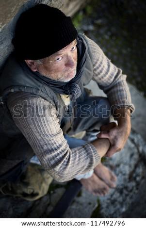 Homeless man on the street - stock photo