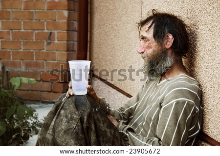 Homeless poor alcoholic in depression. - stock photo