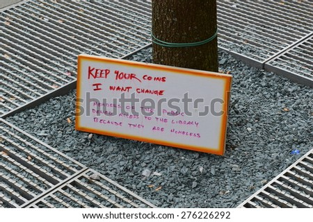Homeless protests in St Peter's Square in Manchester, UK, May 2015 - stock photo