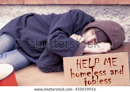 homeless sleeping on a cardboard in landfill - stock photo