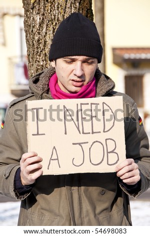 homeless with cardboard looking for a job - stock photo
