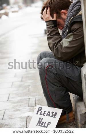 Homeless Young Man Begging In Street - stock photo