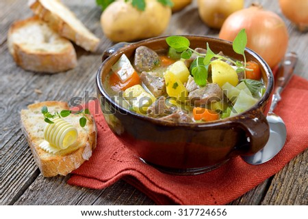 Homemade and slow cooked Irish stew with lamb, potatoes and other vegetables - stock photo