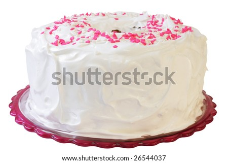 Homemade angel food cake with pink and white hearts on top.  Includes a clipping path. - stock photo